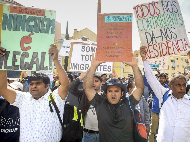Immigrants protest outside parliament over a lack of documents