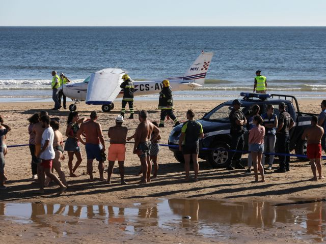 Man and child killed after light aircraft makes emergency landing on packed Caparica beach